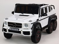 6-ti kolový Mercedes G63 AMG 4x4, dvoumístný, s 2.4G DO, plynulým rozjezdem, USB, otvíracími dveřmi, kapotou, čelem, pérováním, EVA koly, lakovaný ABL1801.white